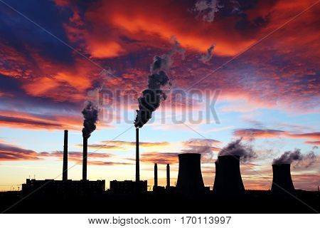 dramatic sunset on the sky and coal power plant factory