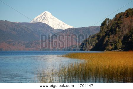 Snowcovered Lanin volcano in Lanin national park seen from across Lake Quillen poster