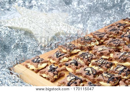 group of christmas sweets on wooden board