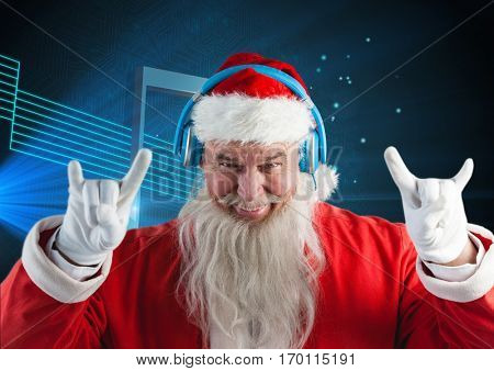 Santa claus listening to music on headphones against blue background