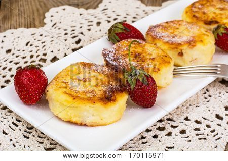 Cheese fritters with honey on plate. Studio Photo
