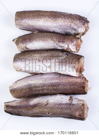 Gutted carcasses of fish on white. Studio Photo