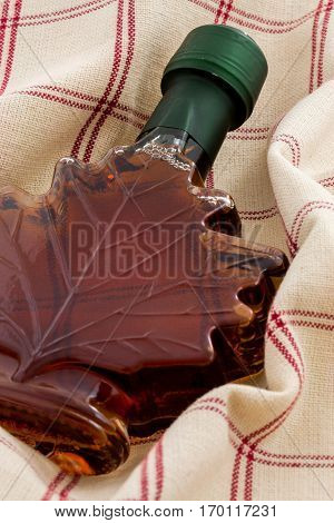 beautiful bottle of styled on marble delicious maple syrup