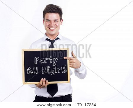 Party All Night! - Young Smiling Businessman Holding Chalkboard With Text