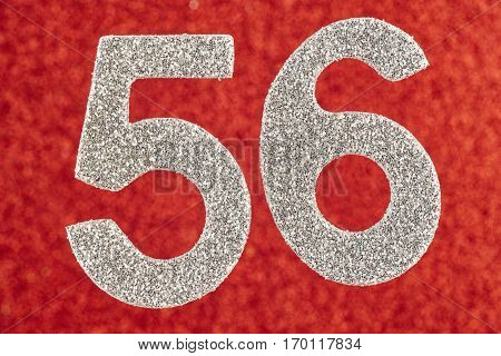 Number fifty-six silver color over a red background. Anniversary. Horizontal