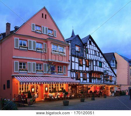 Old street  at Christmas Eve in Bernkastel-Kues, Rhineland-Palatinate, Germany. Toned image