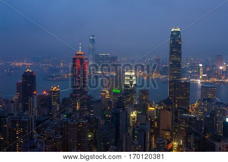 Night view of city in mist and Victoria Harbour in Hong Kong, China, view from Queen Garden