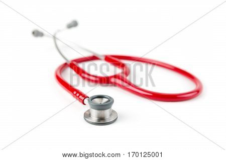 Red medical stetoskop isolated on a white background. Studio shot. Front View. Shallow depth of field. Child care.