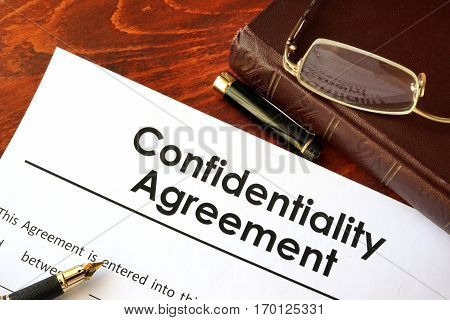Confidentiality Agreement form on a table. Non-disclosure contract.