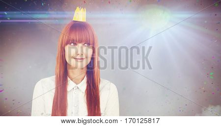 Happy hipster woman with a crowned against illuminated disco lights at disco