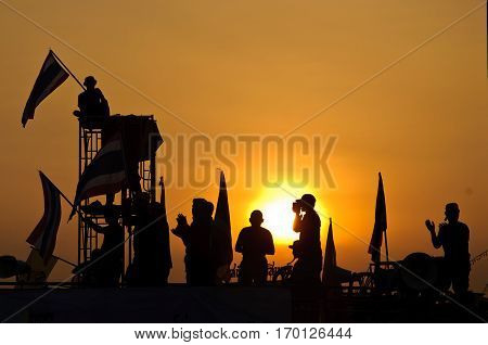 Silhouette Of Thai Protestors And Sunset