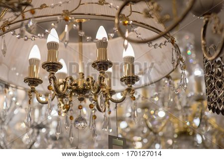 beautiful modern chandelier with bulbs in the interior