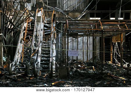 The charred ruins and remains of a burned down at Siam Square, Thailand