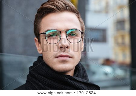 Close up serious business man in glasses on the street