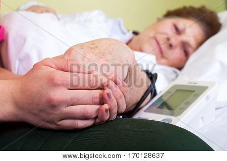 Close up picture of a bed ridden woman with high blood pressure