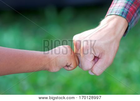 Close up picture of a caucasian and a romany kid's hands