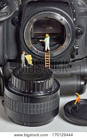 Camera sensor cleaning by figurines, close up