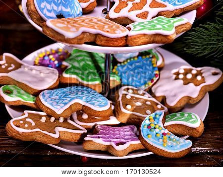Christmas cookies covered with colored glaze on Tiered, Cookie, Stand. Close-up.