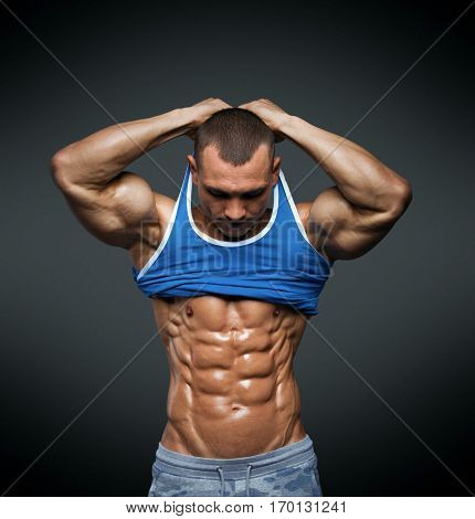 Strong Athletic Man Fitness Model Torso showing big muscles and exellent abs