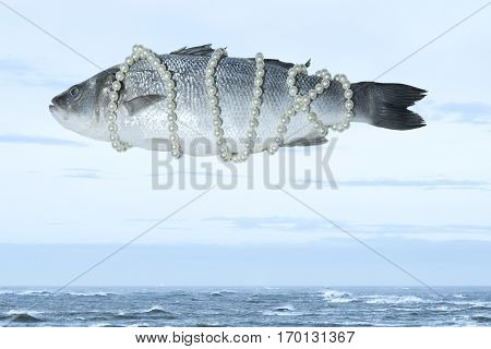 Surrealistic isolated fish with a pearl necklace floating in the sky above the sea Magritte inspired