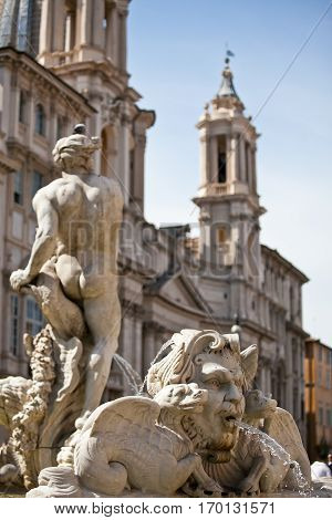 Classical Baroque fountain statue of a nude man in Roma, Italy