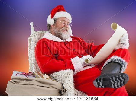 Santa claus sitting on chair and reading wish list
