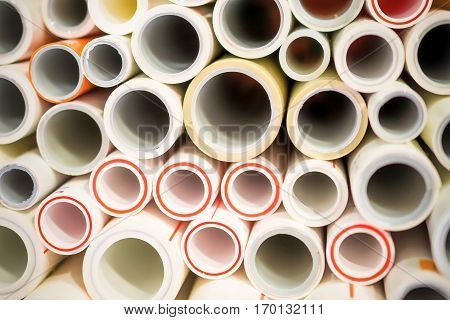 The ends of polypropylene and plastic pipes. Abstract industrial background.