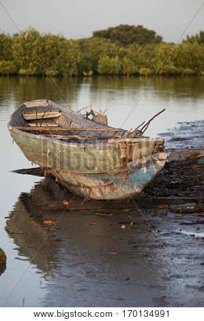 Traditional old Senegalese wooden rowing boat  on the water