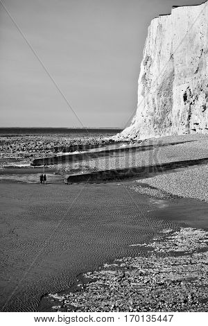 Black and white view of seaside with beach and chalk cliffs, Normandy, France