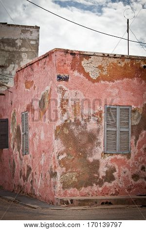 Old House with decrepit pink wall, Saint Louis, Senegal, Africa