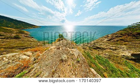 Landscape With Trees On Rock Turquoise Sea Baikal
