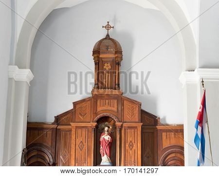 Santiago de Cuba, Cuba- December 3, 2016: Our Lady of Charity of 'El Cobre' interior details. Wooden structure with figure of Jesus Christ inside of a church.