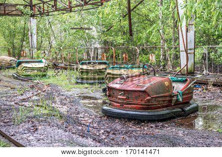 obsolete cars playground in Pripyat park, Chernibyl