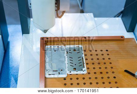 Robot holding glue syringe Injection on phone