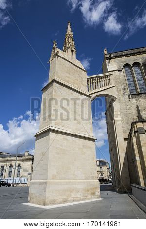 Buttress and flying buttress of Saint-André cathedral, with blue sky background, Bordeaux France