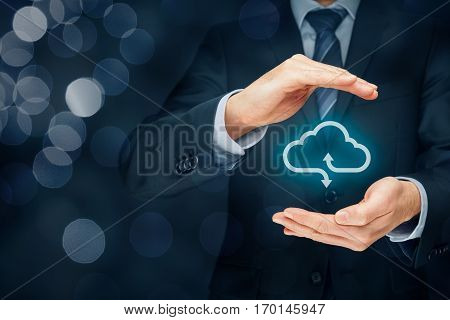 Cloud computing security concept. Businessman or information technologist with cloud computing icon and protective gesture.
