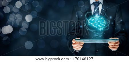 Artificial intelligence (AI), machine deep learning, data mining, expert system software and another modern computer technologies concepts. Brain representing artificial intelligence and businessman holding futuristic tablet.