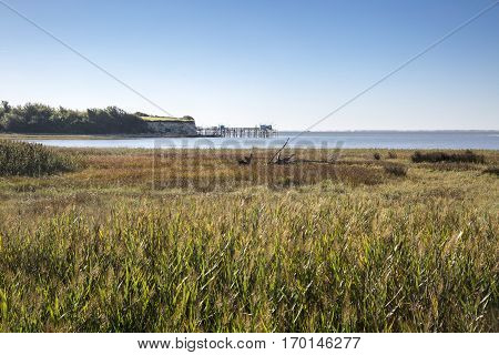 maritime seaside landscape of the Gironde estuary with shiny refection on sun the blue sea