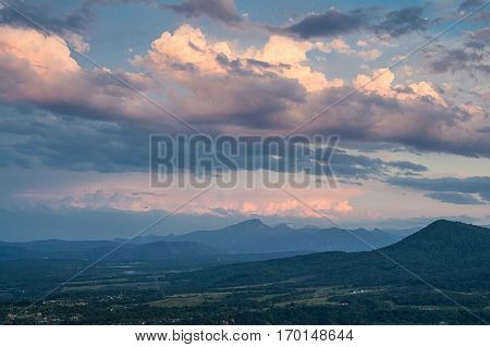 Scenic mountain landscape with sunset and dramatic sky