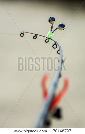 Fish pecks on a rod and the hand bell rings