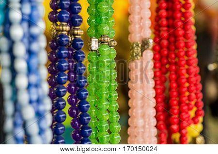 Souvenir beads made of colorful semi-precious stones