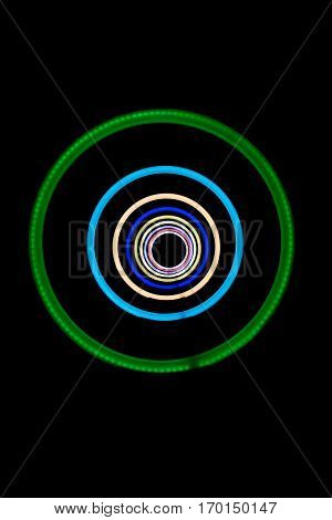 Abstract shiny colorful and hypnotic neon light circles and black background