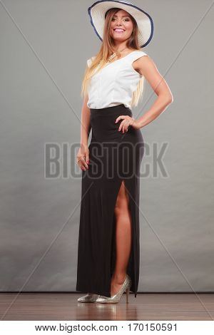 Woman Wearing Long Black White Dress And Sun Hat