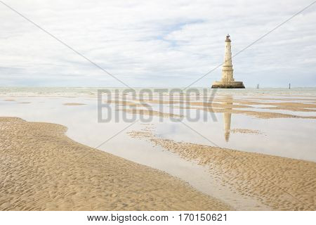 view of the historical lighthouse of Cordouan at low tide Gironde estuary France