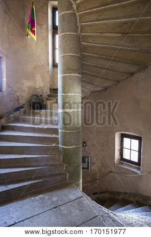 Elliptical medieval castle stone staircase and small windows