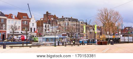 Leiden, Netherlands - April 7, 2016: Panorama with traditional dutch houses, boat station in Leiden, Holland