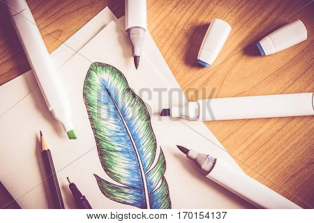 Drawing Practicing and the Drawing Equipment. Colorful Draw Pens. Feather Illustration.