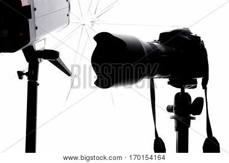 Pro Photo Studio Equipment. Modern Digital Camera in the Studio with Umbrella Flash Lights