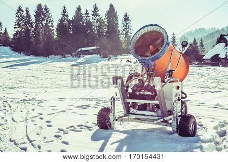 Snow Making Gun on the Ski Slope. Winter Skiing Slope Equipment.