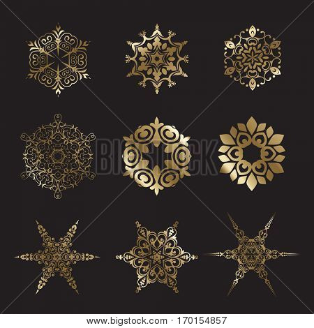 Collection of decorative gold snowflake designs